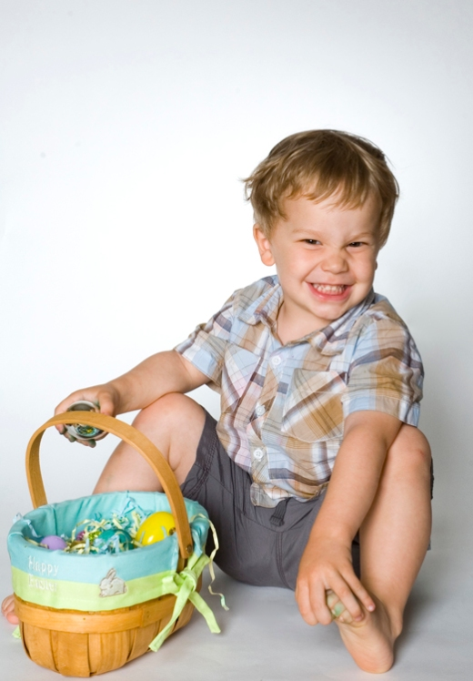 a boy with an easter basket and a mischevious look